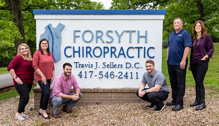 Chiropractor Forsyth MO Travis Sellers with Team